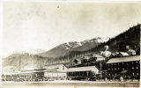[Treadwell, Alaska – ball field in foreground, natatorium and bunk houses in background.]