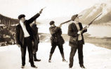 [Group of 4 guys aiming guns toward the sky.]