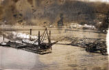 [Dredge at work on Juneau small boat harbor. Starting at entrance to remove material to a depth of...