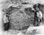 "[Father Hubbard beside rock signed ""University of Santa Clara 1929""]"