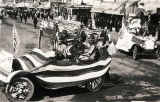 [Decorated automobiles leading the 4th of July parade, Anchorage, Alaska 1918.]