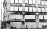 [People view Goldstein Building fire damage.]