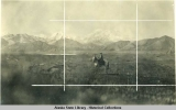 Woman sitting on horse with snow capped Mount McKinley behind her.