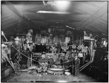 Interior of Chief Shakes house. Wrangell, Alaska. Curios, totems, etc. April 18, 1915.
