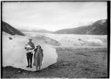Man, woman and child at edge of glacier.