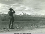 A park ranger viewing the scenery of the Alaska Range.