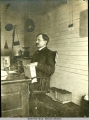 James Wickersham seated at desk with law books.