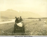 Snap shot of first and second ambulance from third ambulance headed for Valdez with men wounded by...