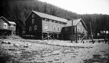 [Large cannery building on pilings.]