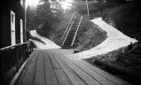 [Paths and staircase off of wooden walkway.]