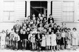 [School children on steps of the old school in Unalaska.]