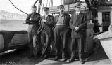 S.S. Dora Alaska. T. [Four men standing on deck of boat.]