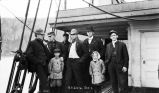 S.S. Dora. Oct. 1. J.E.T. [Six men and two children standing on ship deck]