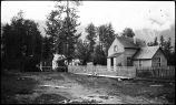 [House with fenced yard.]