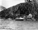 [Ferry at downtown Juneau in front of Alaska Juneau Mine buildings.]
