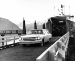 [Passenger vehicle departing Ferry.]