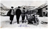 Bill Frame fixing motorcycle at Chitina 1916 March 1st-3rd.