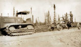 Alaska Road Com. 1933 about [road equipment; one driver].