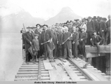Judge R.A. Gunnison driving the first (a copper) spike in laying the first rails of the...