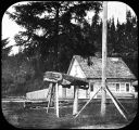 [Possibly Fort Wrangell, with totemic carving of killer whale.]
