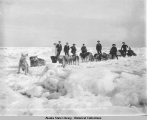 Sport Smith bringing first mail ashore from S.S. CORWIN 5 miles out on Bering Sea, Nome. June 2d,...