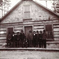 Skagway, Alaska.  Natives standing in front of City Hall.
