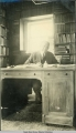 James Wickersham behind his desk.