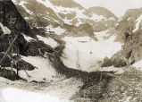 [Tram carrying supplies over snowy mountain pass.]