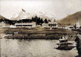 Sitka, Alaska. [Old military barracks, Russian Church, and Tlingit canoe in view, ca. 1900.]