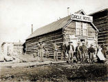 [Men standing in front of Circle Hotel on Ophir Creek near Nome, ca. 1900.]