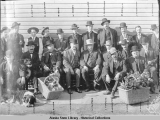 James Wickersham and group of men wearing hats.