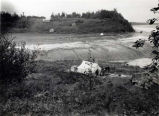 Camp of Little Nikita, Tanaina Indian, with Ulanky's farm in distance, Fish Creek, August 25.