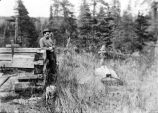 Viewing grave of Chief Chickalusion, Tanaina Indian, left, and another nearby; Bill Newman, front,...