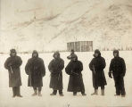 Sergt. A. A. Tower and guard in buffalo coats 1903 at Fort Egbert, Alaska.