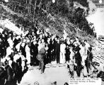 "[President Warren G. Harding driving the ""Golden Spike"" on the Alaska Railroad at Nenana, Alaska,..."
