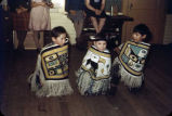 [Three children wearing small Chilkat robes, Klukwan (PC).]