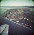 [Beach area and town, seen from the air.]