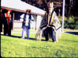 Man in Chilkat Robe and Shukiut and three women in Coho regalia at Sitka National Park.