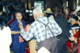 Minnie Howard and Willie Marks cutting a rug and putting down money.