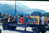 4th of July Parade- people dressed in traditional regalia with truck float.