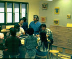 Ray Peck with students in a school or workshop.
