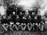 [Fort Snelling: officers on duty 1884-1887 (includes Edwin F. Glenn): 12 men in uniform posing in...