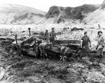 [Holtz Bay, Attu, Aleutian Islands: American soldiers digging tractor from mud, May 12, 1943.]
