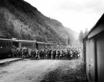 [Soldiers boarding train from outpost after construction of Alaska-Canadian Military Highway,...