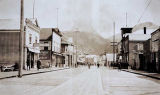 Street scene in Wrangell – note historical canon relic of early days in front of place where...