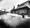 [Lincoln Street.  Sitka; St. Michael's Cathedral, center, background; people on sidewalk at right.]