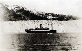 Postcard. Taku Glacier Alaska with vessel along face of glacier.