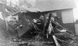 Postcard: Wrecked by slide during storm September 26, 1918, Gastineau Ave., Juneau, Alaska.