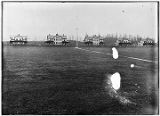 [Officers' Row at Fort William H. Seward (5 buildings) in background, Parade Ground in foreground.]