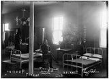 Band Squad Room Ft. Seward, Alaska; Edw. G. Perkins [Two men in uniform sitting near cots in...